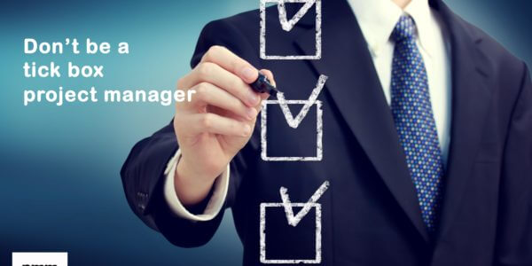 Project manager ticking check boxes