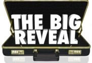 """Open suit case with text """"the big reveal"""""""